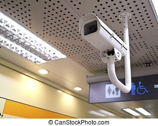 security camera on wall in public space indoor
