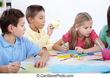 Children at leisure - Smart schoolboys and schoolgirl...