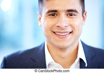 Face of businessman - Face of cheerful businessman looking...
