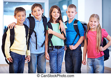 Schoolmates - Portrait of smart schoolkids standing in line...