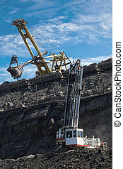 work in coal mine drill, coaches and excavator