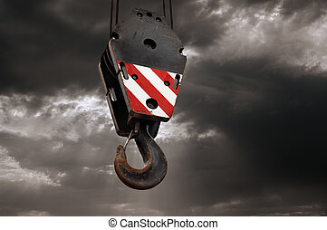 Crane hook on a dramatic sky background - construction...