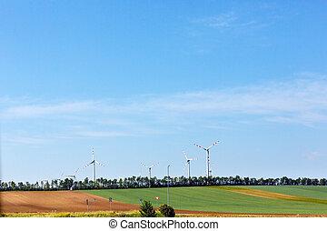 Wind turbines on blue sky background