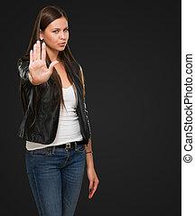 jovem, mulher, mostrando, parada, mão, gesto