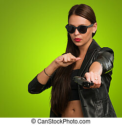 Girl Aiming With Gun against a green background