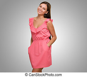 Beautiful Woman In Pink Dress against a grey background