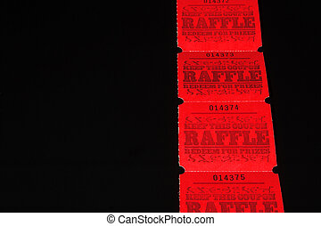 Raffle Tickets - A strand of bright red raffle tickets.