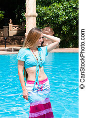 pretty woman with long hair at the pool
