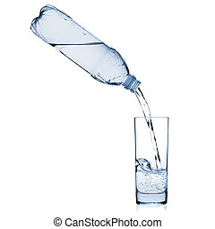 Water is poured into a glass from a bottle. Isolated on...