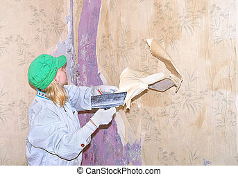 Wallpaper removing by spatula - Repair Woman Worker...