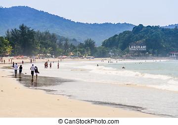 Langkawi Beach - tourists walking on the beach in Langkawi,...
