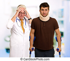 Young Man Wearing Cervical Collar And Frustrated Doctor...