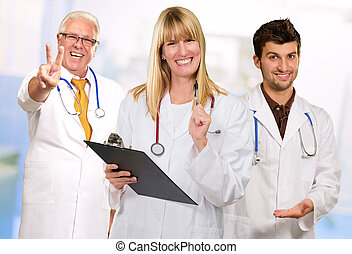 Happy Female Doctor Holding Clipboard Infront Of Happy Male...