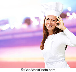 Woman chef gesturing, outdoor