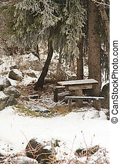 Beautiful winter with a  picnic table and benches in the snow in Kazakhstan, Almaty