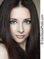 Beautiful woman model with green eyes and natural makeup....