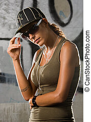 Hip-hop girl - Hip-hop styled girl posing in front of a...