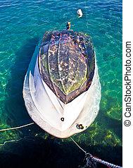 Sunken motor boat after storm