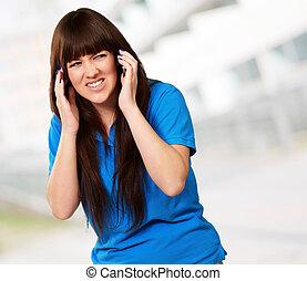 Woman Disturbed By Noise, Indoor