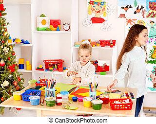 Children in kindergarten - Children in kindergarten stacking...