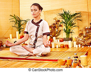 Bamboo massage at spa and woman.
