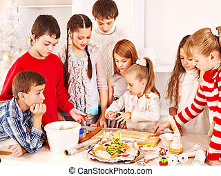 Children rolling dough in kitchen - Children rolling dough...
