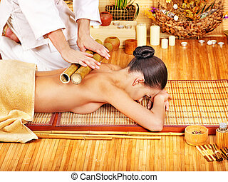 Woman getting bamboo massage. - Young woman getting bamboo...