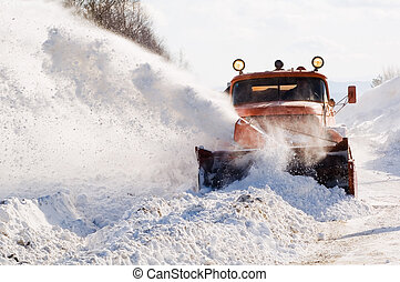 Snowplow at work - Snowplow removing snow from intercity...