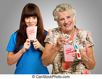Mother And Daughter With Pop Corn, Ticket And 3d Glass On...