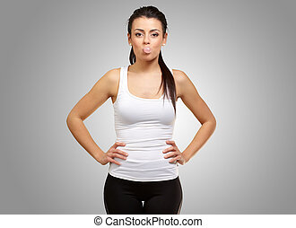 Female Blowing Bubble Gum On Gray Background