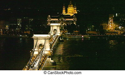 Budapest Night view of chain Secheni Bridge and St Stephanes...