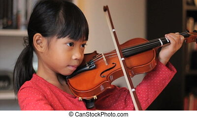 Asian Girl Practices Her Violin - A pretty 6 year-old Asian...