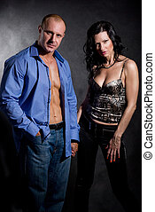 Muscular handsome sexy man with pretty woman