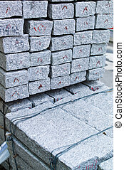 granite stones for paving a road on a road construction site