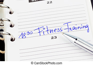entry in the calendar: exercising - a date is entered in a...