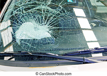 broken windshield and airbag - a broken windshield and an...