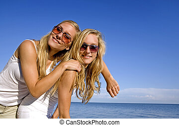 twins in the summer - sisters wearing yellow top and jeans...