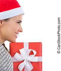 Smiling woman in Santa hat with Christmas gift box