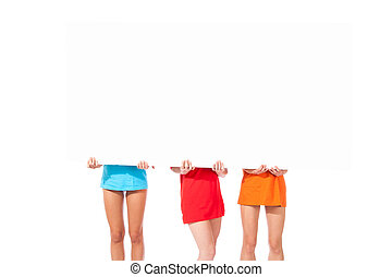 Three girls with white message board - photo of three...