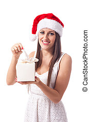 Smiling girl with Christmas gift - isolated - beautiful...