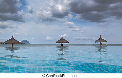 Infinity Pool against Stormy Skies - Low angle landscape...