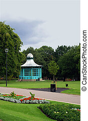 The Park Pavilion - A park\\\'s green space with trees and...