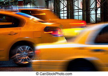 Yellow taxi cabs in blurred motion in New York