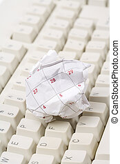 Calendar paper ball and computer keyboard, concept of time...