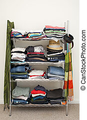 Clothes Rack Wardrobe - Clothes rack with stacked clothes...