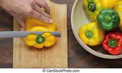 slicing board - peppers preparation , slicing a yellow...