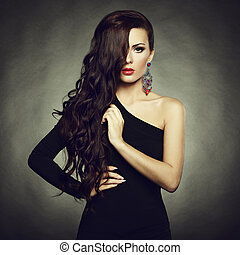 Portrait of beautiful brunette woman in black dress Fashion...