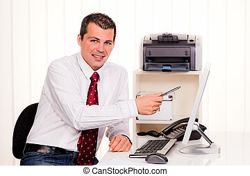 businessman in office with computer - young businessman in...
