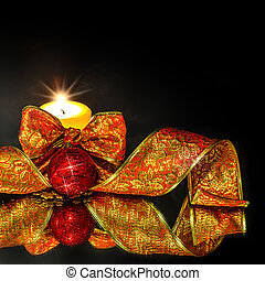 Christmas Decorations background with candle and ribbon on a...