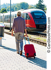 mature aged couple at the train station - mature vital...